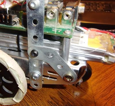Antenna/can mount, screwed onto Boe-Bot chassis. I built mine out of Erector set pieces.