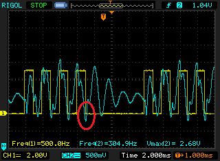 "When the antenna is not facing the transmitter, the blue waveform changes. This time the antenna is facing the opposite direction from the above picture. Notice how the blue is ""low"" in this picture where the yellow waveform ended. If you left the walkie talkie speaker on, you should hear a low, noisy tone coming from it."
